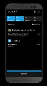 A Windows phone action center displays an thunderstorm watch alert from MyRadar